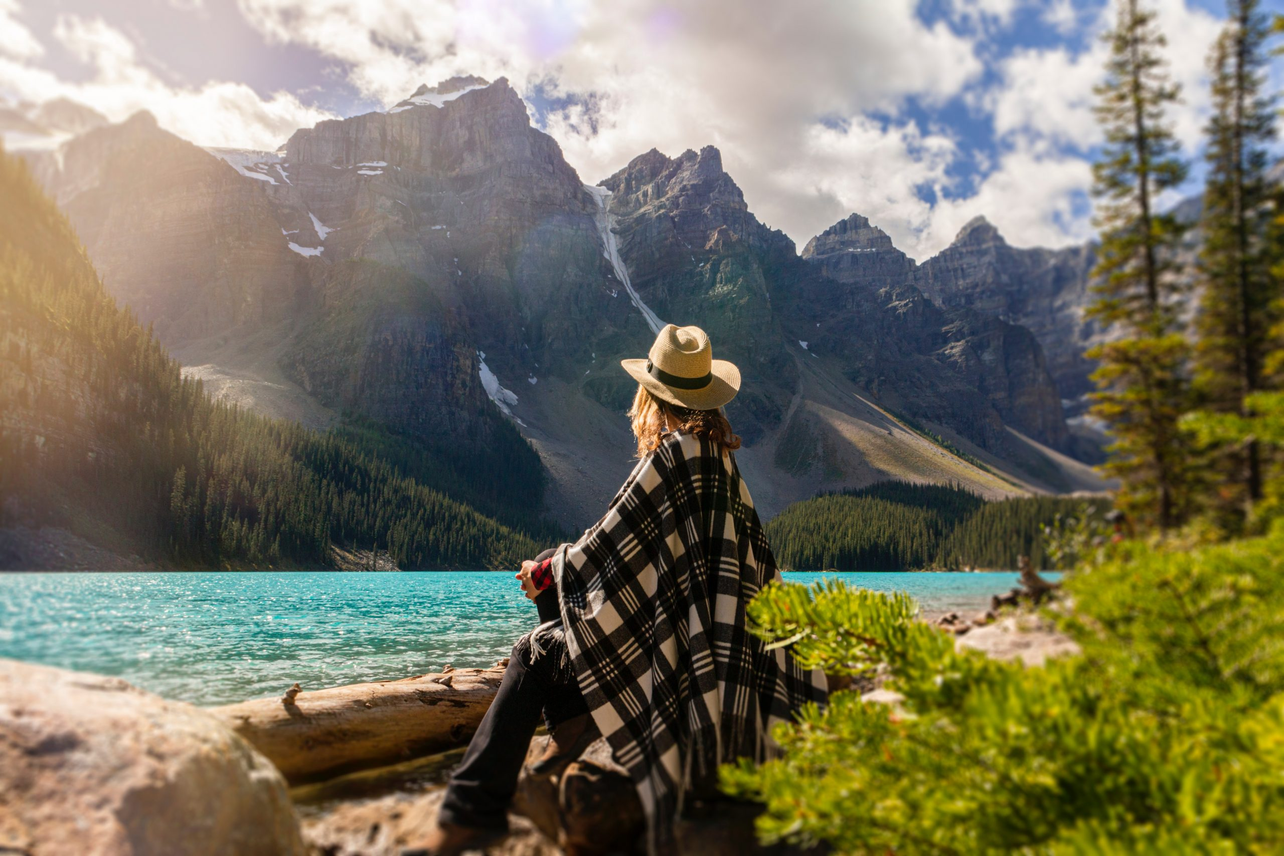 a-woman-sits-on-a-rock-beside-the-lake-2916820